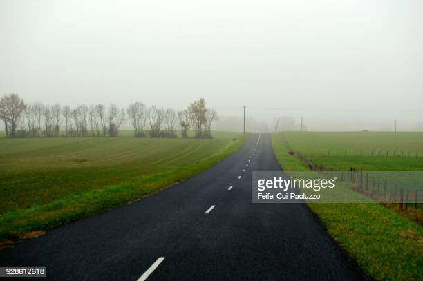 road rural scene at saint-didier-sur-chalaronne, ain department, france - ain france stock pictures, royalty-free photos & images