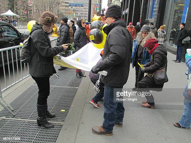 CONTENT] Road safety campaigners pack up their signs after a rally outside the inauguration of Bill de Blasio New York's new mayor calling on him to...