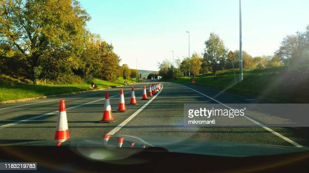 road safety cones. road works - construction barrier stock pictures, royalty-free photos & images
