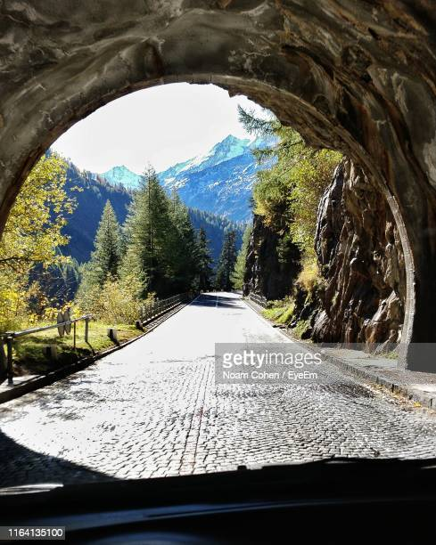 road seen through car windshield - noam cohen stock pictures, royalty-free photos & images