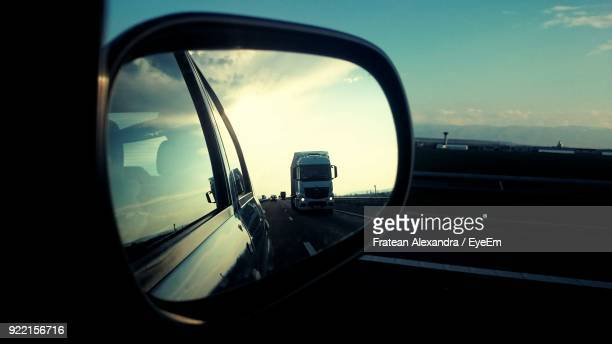 road seen through side-view mirror of car - side view mirror stock photos and pictures