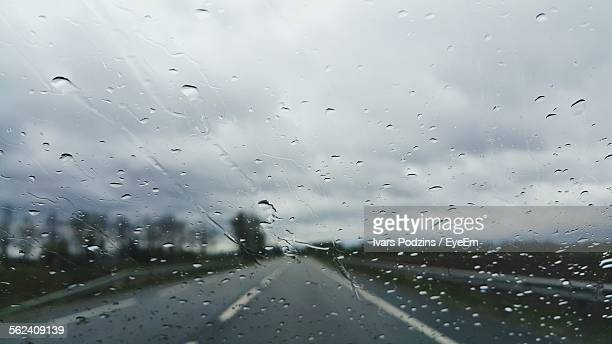 Road Seen Through Wet Windshield Of Car