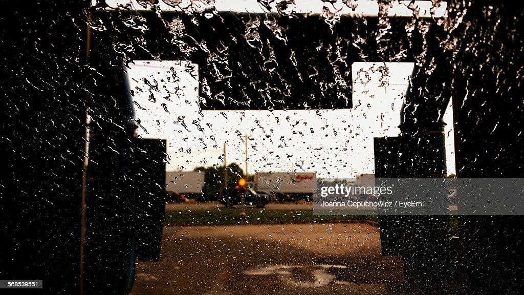 Road Seen Through Windshield During Car Wash : Stock Photo