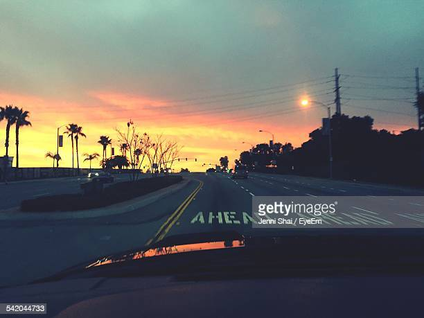 Road Seen Through Windshield During Sunset