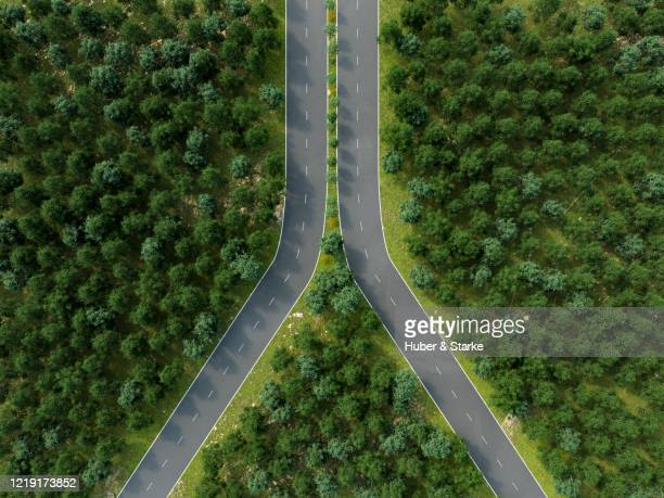 road shaped as zipper around trees - integrated stock pictures, royalty-free photos & images