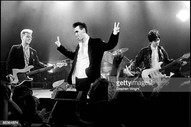 Photo of Andy ROURKE and MORRISSEY and Johnny MARR and The Smiths LR Andy Rourke Morrissey Johnny Marr performing 'The Headmaster Ritual' on the...