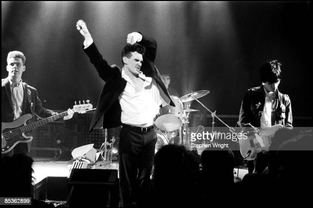 Photo of The Smiths and MORRISSEY and Mike JOYCE and Johnny MARR and Andy ROURKE LR Andy Rourke Morrissey Mike Joyce Johnny Marr performing 'The...