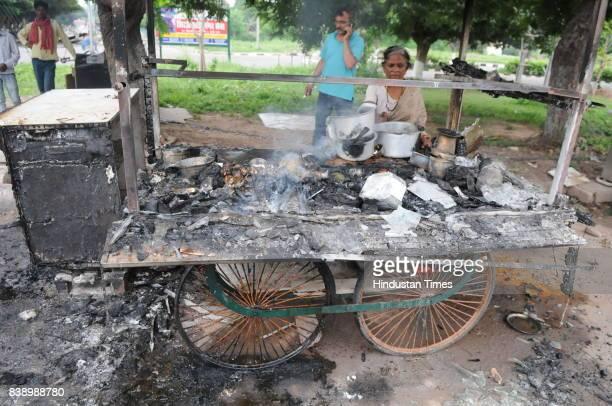 A road side vendor showing her cart after Dera followers burnt during a violence after Verdict by CBI Court against Gurmeet Ram Rahim Singh Insan on...