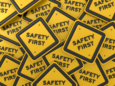 SAFETY FIRST Road Sign - 3D Rendering 1060912048