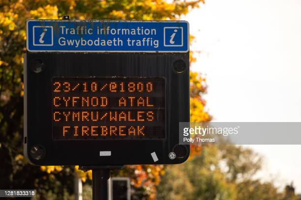 Road sign advising people that the lockdown will begin at 6pm on October 23, 2020 in Cardiff, Wales. Wales will go into a national lockdown from...