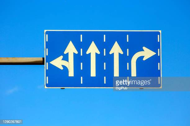 road sign against blue sky - 道路標識 ストックフォトと画像