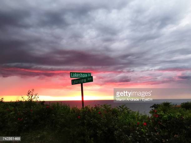 Road Sign Against Dramatic Sky