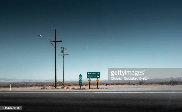 road sign against sky - christian soldatke stock pictures, royalty-free photos & images