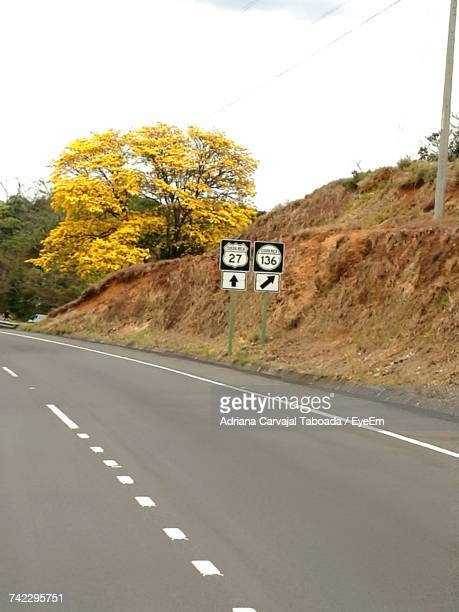 road sign against sky - carvajal stock photos and pictures