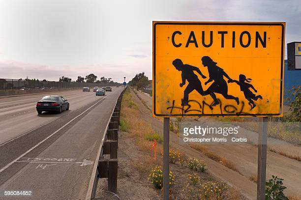 A road sign along Interstate Highway 5 near San Ysidro California warns motorists to watch out for migrant workers crossing the highway According to...