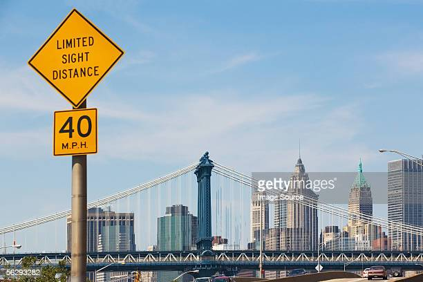 road sign and manhattan skyline - speed limit sign stock photos and pictures