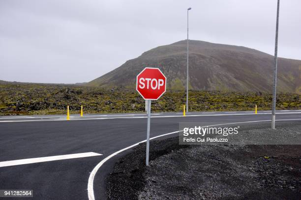 road sign at grindavík, reykjanes peninsula, iceland - stop sign stock pictures, royalty-free photos & images