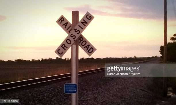 road sign at sunrise - crossing sign stock pictures, royalty-free photos & images