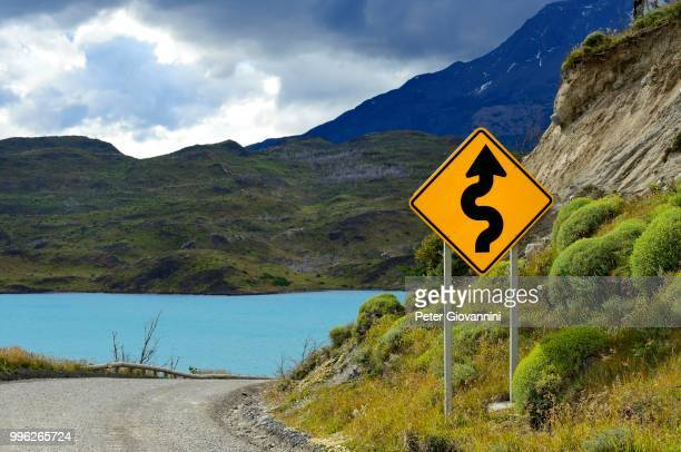 Road Sign Attention curves at Lago Pehoe, Torres del Paine National Park, Ultima Esperanza Province, Chile