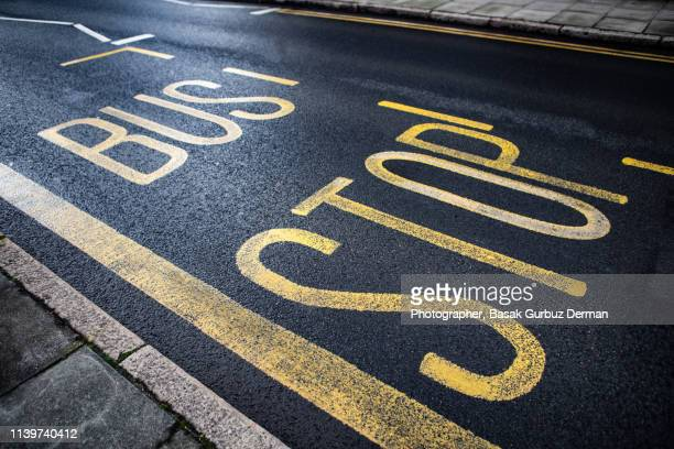 """Road sign """"Bus Stop"""" painted on the road"""