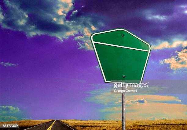 Road sign by a highway