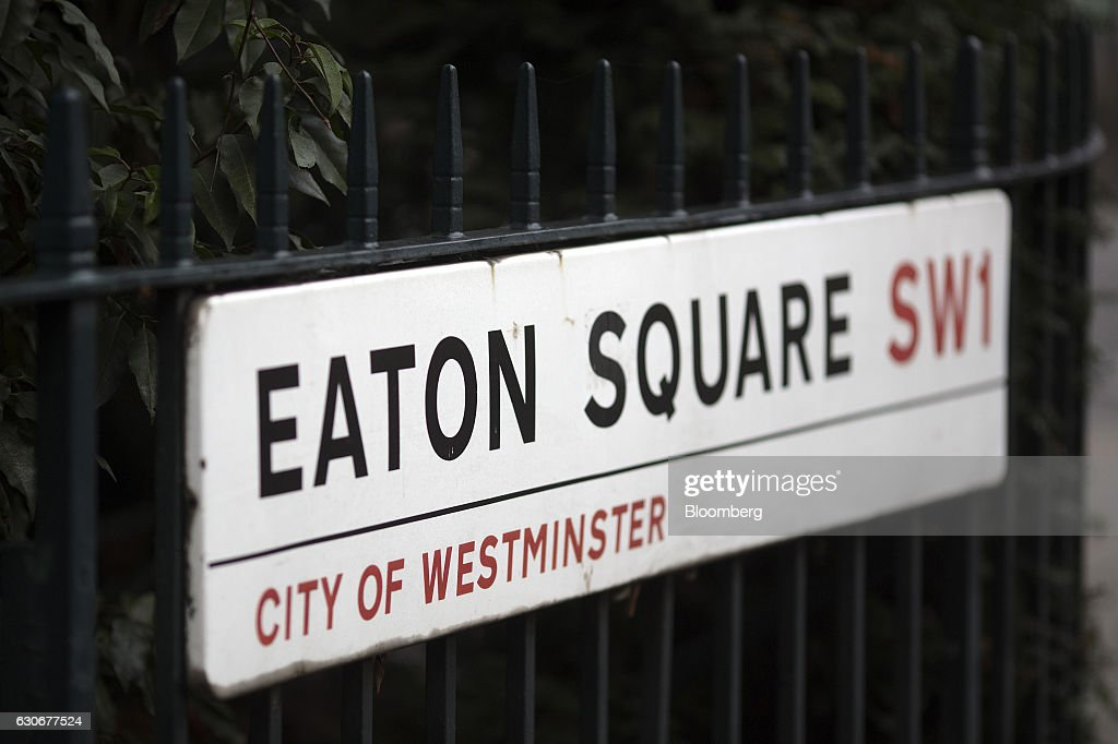 A Road Sign For Eaton Square, SW1, Sits On Cast Iron Railings Outside  Residential