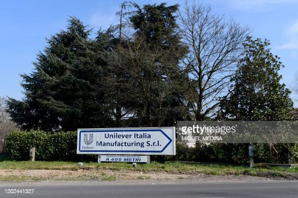 Road sign for the Unilever plant in Casalpusterlengo, southeast of Milan, is pictured on February 22, 2020. - Streets were deserted and residents...