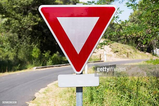 Road sign - give way - at a country road