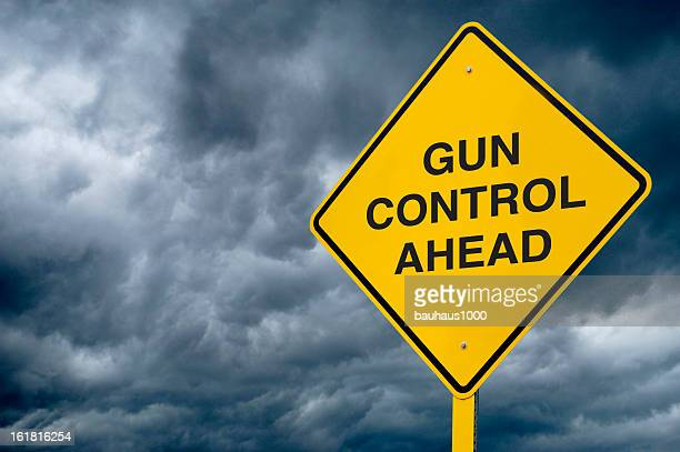 road sign - gun control - gun control stock pictures, royalty-free photos & images