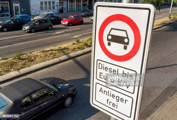 A road sign in Hamburg's Max Brauer Allee warn motorists that older diesel veichles are banned from using this stretch of road in the north German...