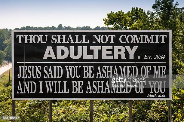 Road sign in Kentucky about morals To not commit adultery taken from the Ten Commandments of the Old Testament in the Bible and to not be ashamed of...