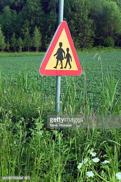 Road sign in middle of field