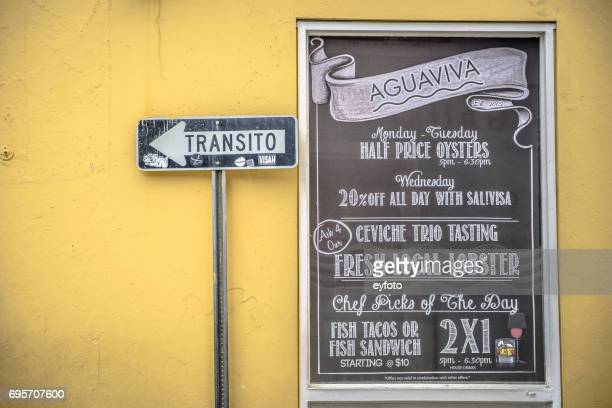 road sign in old san juan - historical geopolitical location stock photos and pictures