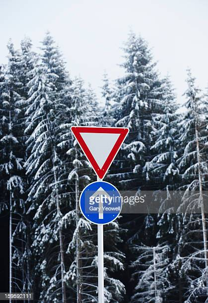 road sign in snowy landscape - yeowell stock photos and pictures
