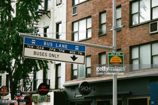 Road sign indicating a designated lane for buses and public transit vehicles approaching the Queens Midtown Tunnel in Manhattan New York City New...