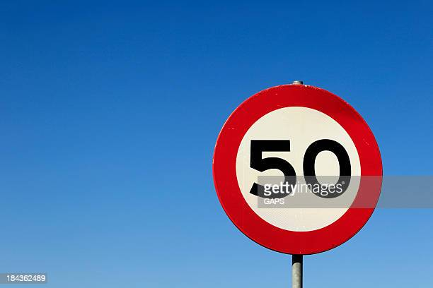 road sign indicating a maximum speed of 50