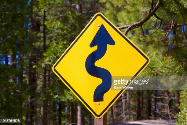 Winding road sign stock photos and pictures getty images road sign indicating winding road publicscrutiny Images