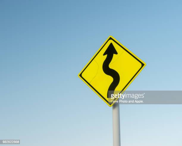 road sign, meandering attention - road sign stock pictures, royalty-free photos & images