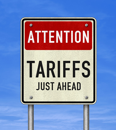 Road sign message - Tariffs just ahead 1154622060