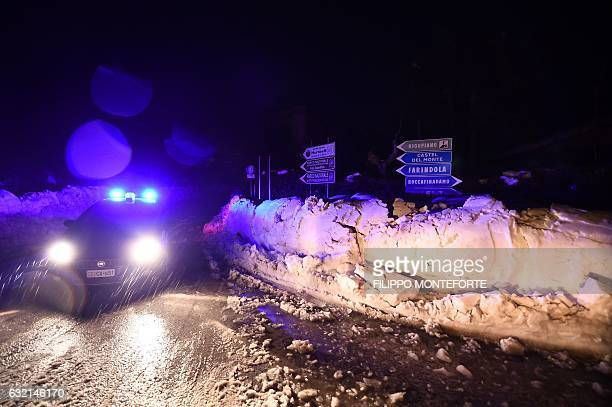 Road sign near Penne leads the way to the mountain hotel Rigopiano in Farindola after an avalanche engulfed the hotel in earthquake-ravaged central...