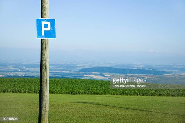 road sign of the letter p, countryside in background - letter p stock pictures, royalty-free photos & images