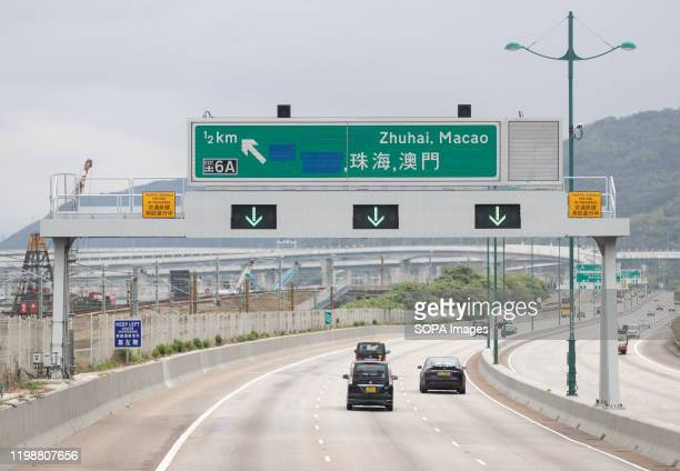 A road sign of Zhuhai Macao direction seen on North Lantau Highway Chief Executive Carrie Lam said on Monday that all border crossings would be...