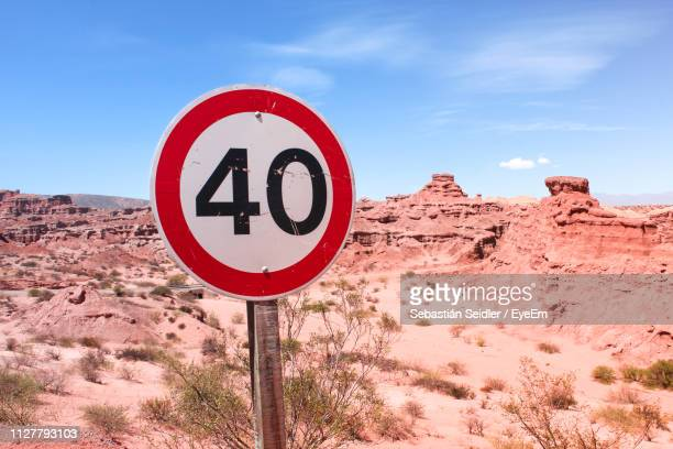 road sign on landscape against sky - number 40 stock photos and pictures