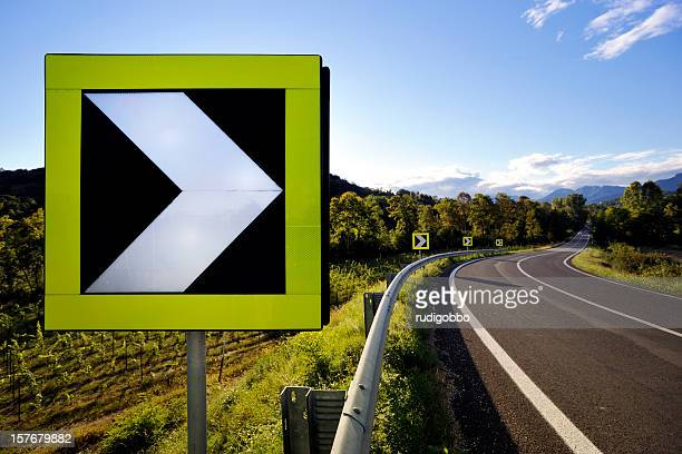 road sign - curved arrows stock pictures, royalty-free photos & images