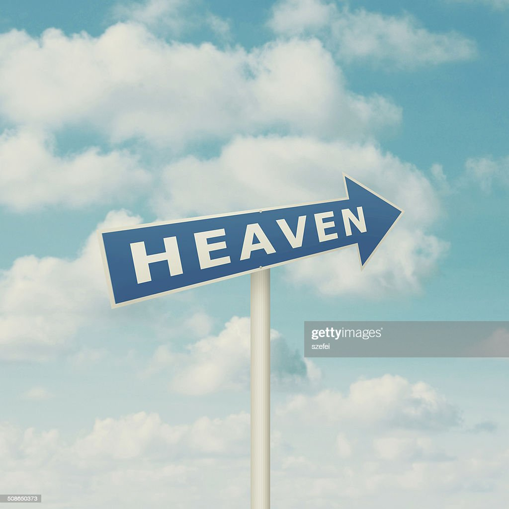 Road sign pointing to heaven : Stock Photo