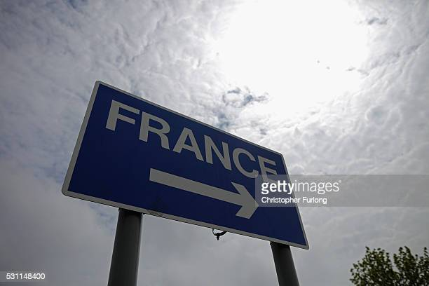 A road sign points the way to France at the Eurotunnel terminal on May 10 2016 in Folkestone United Kingdom The United Kingdom is not part of the...