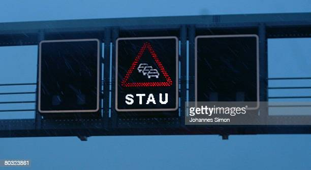 A road sign reading Stau is seen over a motorway on March 20 near Munich Germany In Germany Easter time marks the beginning of a lively holiday...