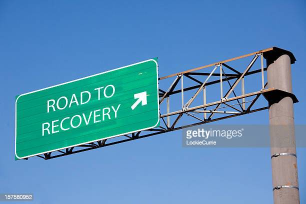 road sign to recovery - recovery stock pictures, royalty-free photos & images