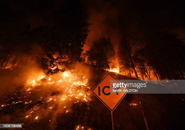 A road sign warns for ice as the Carr fire continues to spread towards the towns of Douglas City and Lewiston near Redding California on July 31 2018...