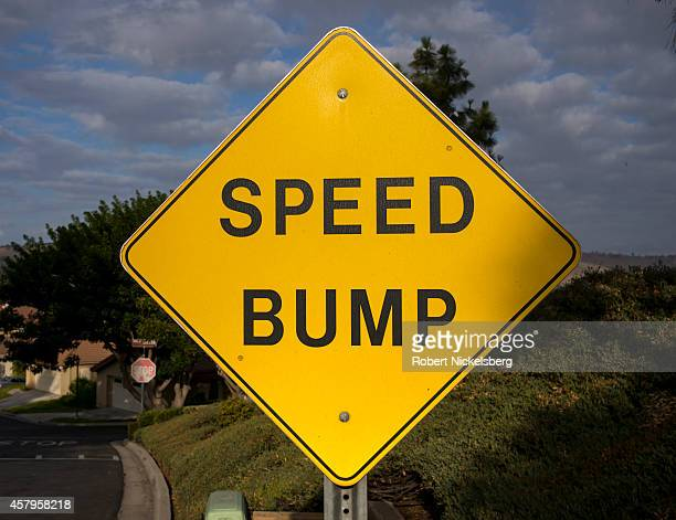 A road sign warns vehicular traffic about a speed bump in a residential area October 18 2014 in San Juan Capistrano California